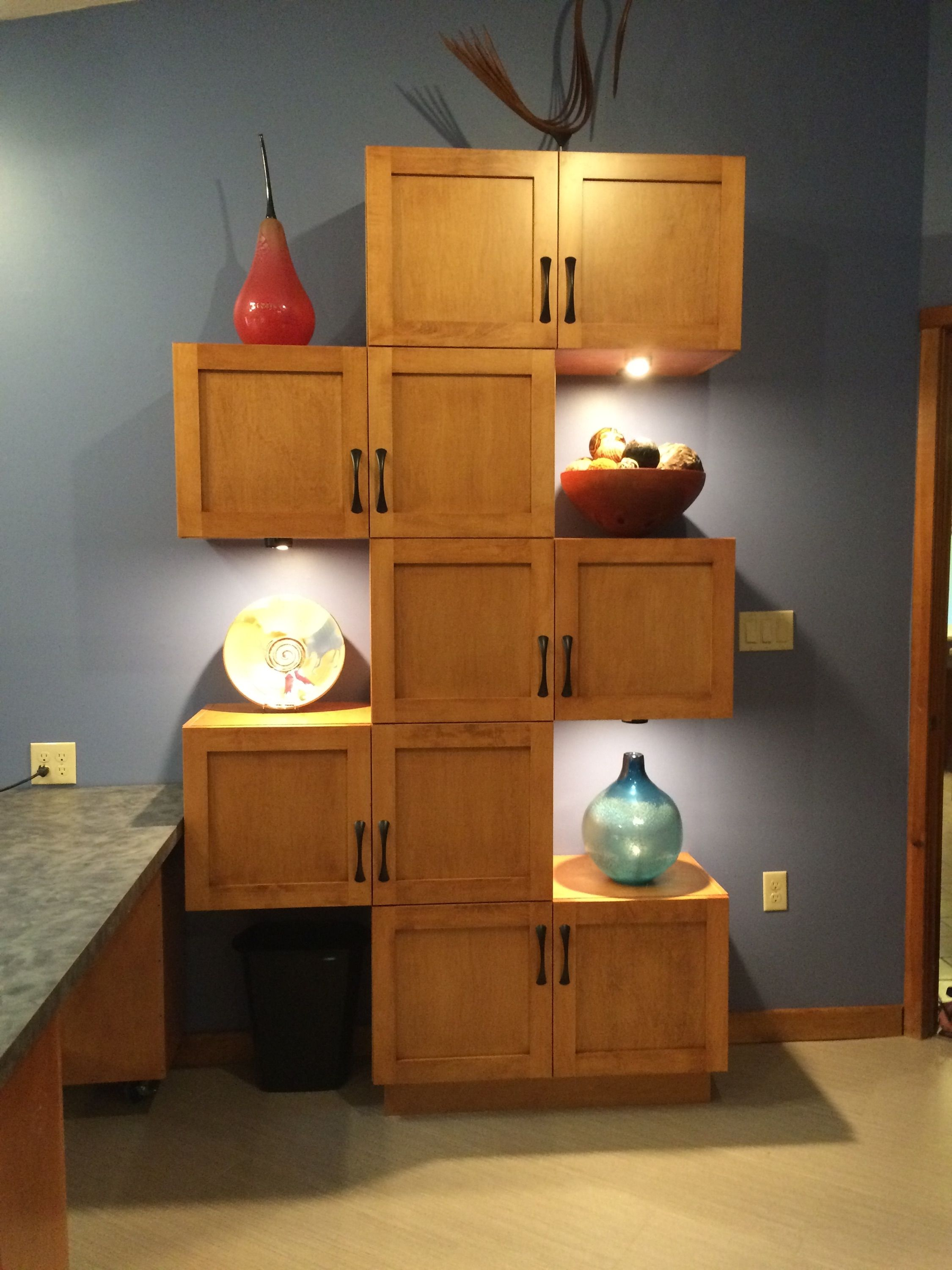 stacking wall cabinets makes an impressive display area ...