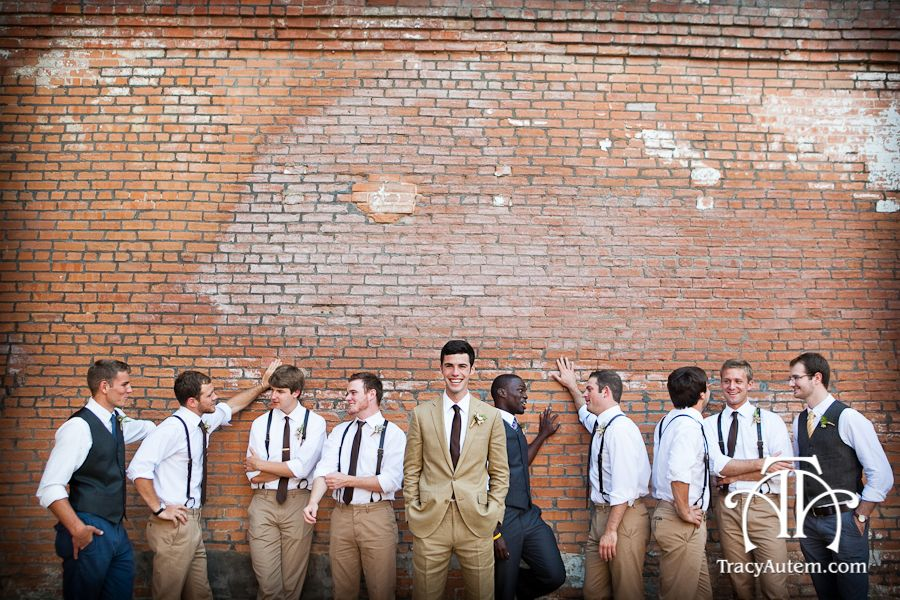 Groom With Groomsmen And Ushers In Front Of Vintage Wall At
