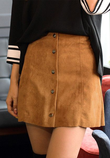 31de96bc58c This brown suede A-line skirt features a line stitch detail in the front  with button fly.