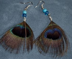 Feather peacock earrings made by melva