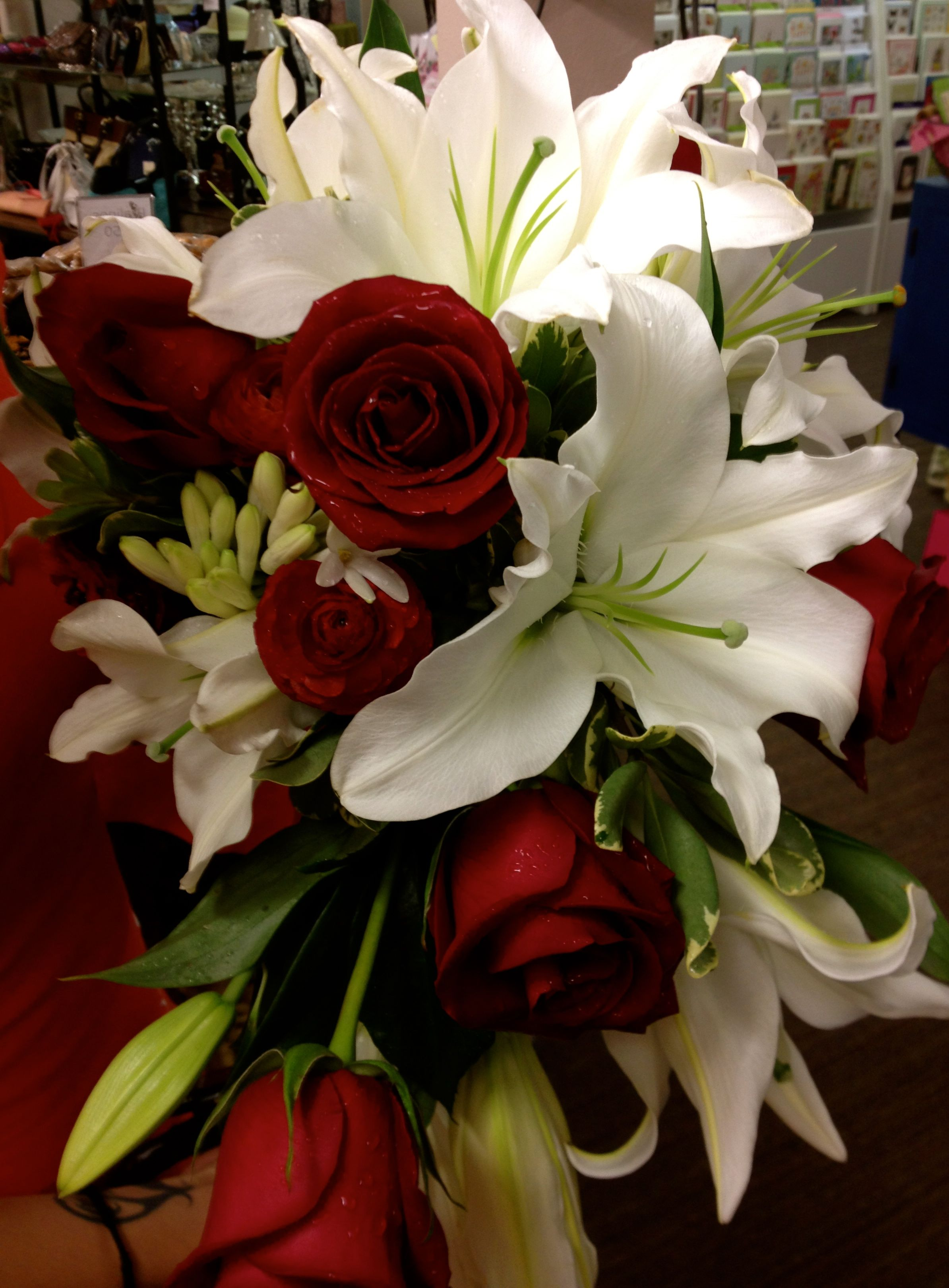 Cascade of white lilies and red roses flower bouquet
