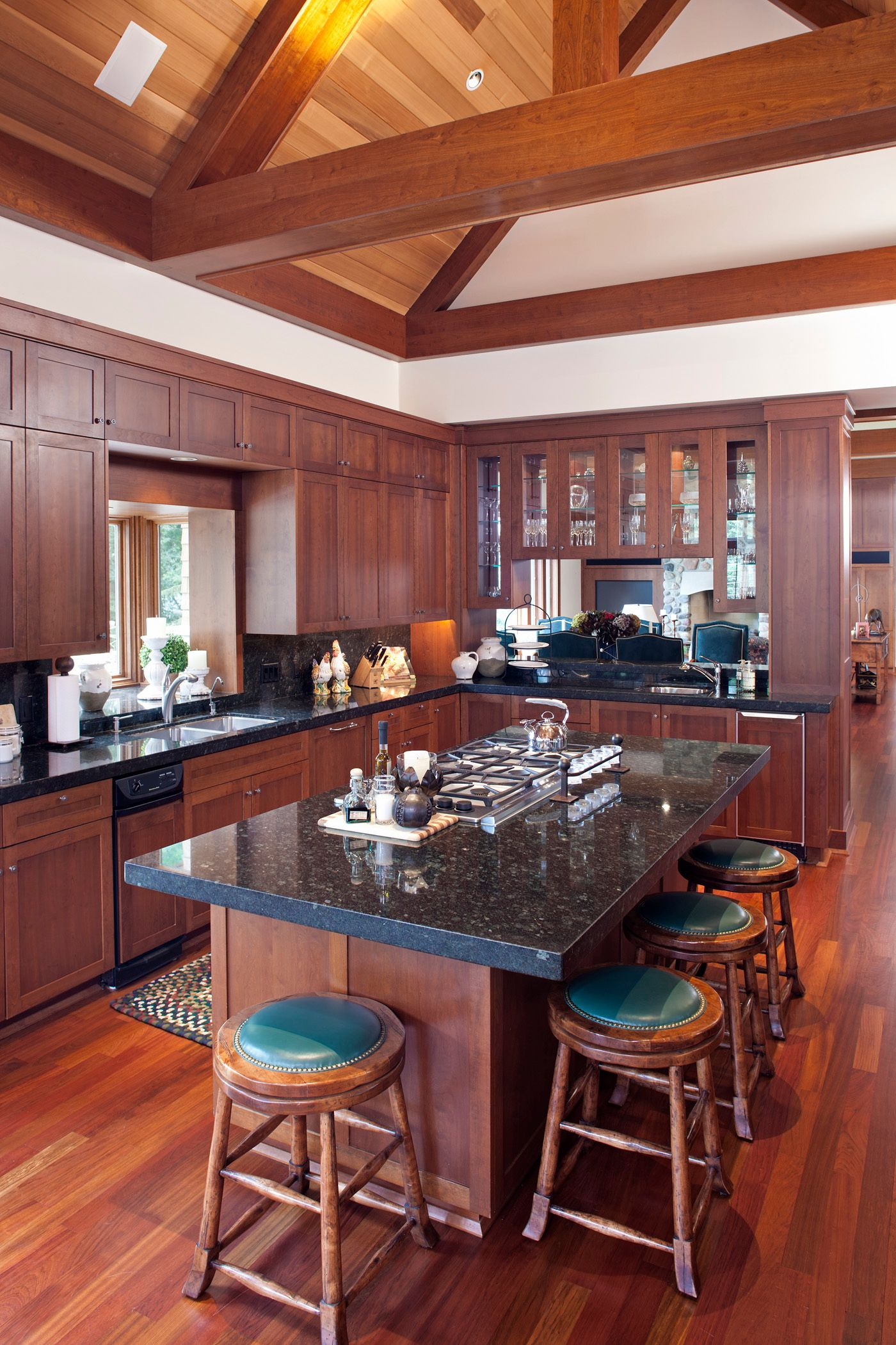 Love this custome kitchen with cathedral beamed ceilings
