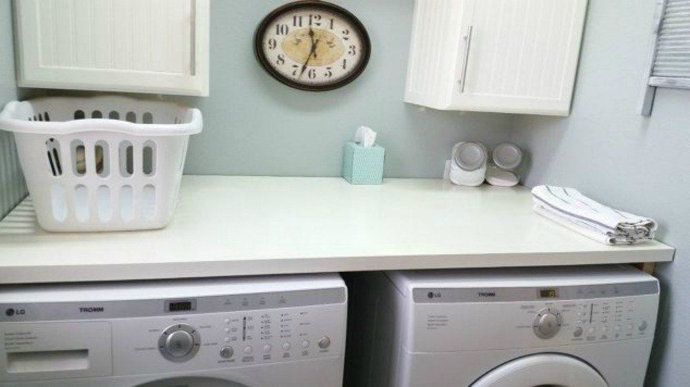 They wanted their tiny laundry room to look bigger and brighter ...