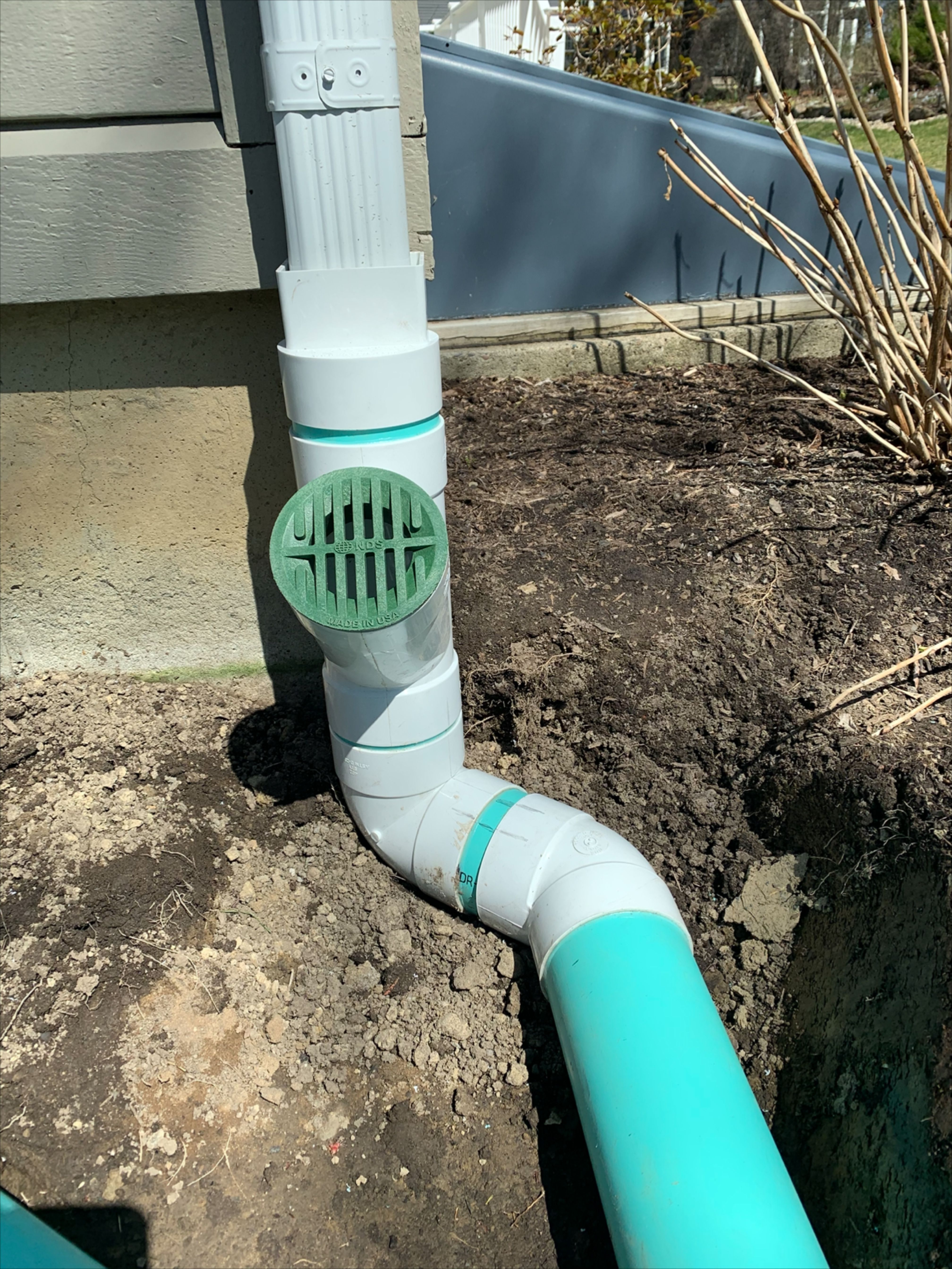 Basement Waterproofing And Drainage Solutions Extending Gutter Downspout With Underground Piping In 2020 Drainage Solutions Drainage Pvc Gutters