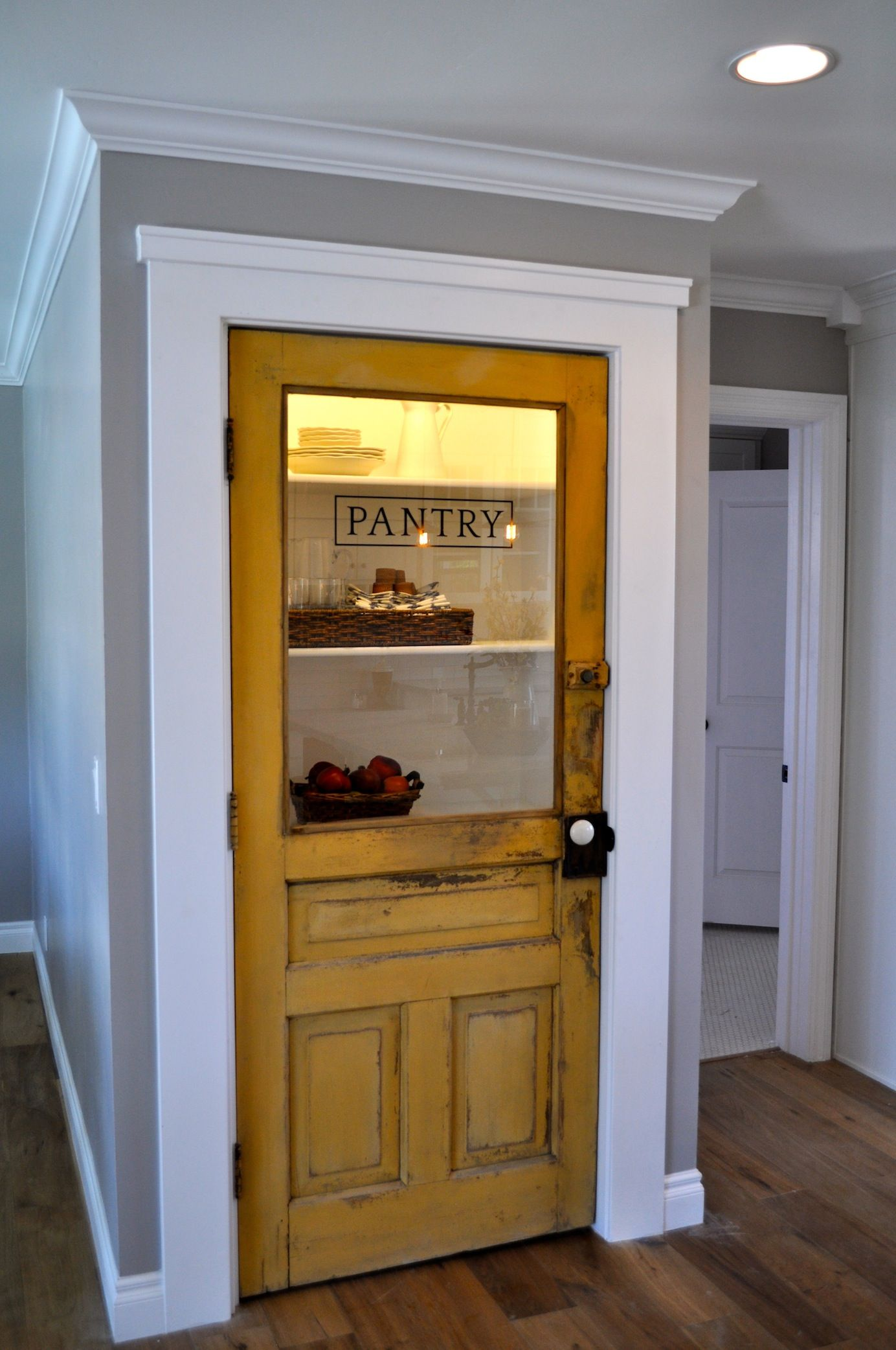 Vintage farmhouse door repurposed as pantry door love this for Kitchen entrance door designs