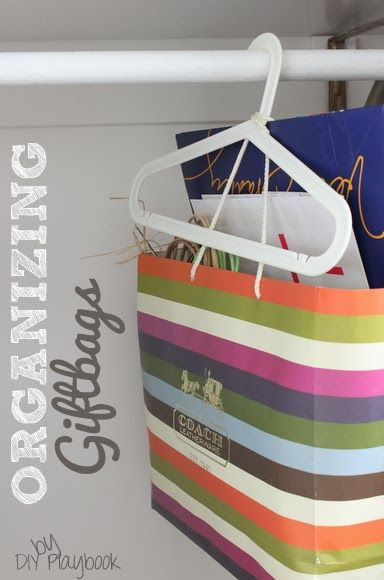 How To Organize Old Gift Bags For Free Using A Clothes Hanger Gift Bag Organization Organization Gifts Gift Bag Storage