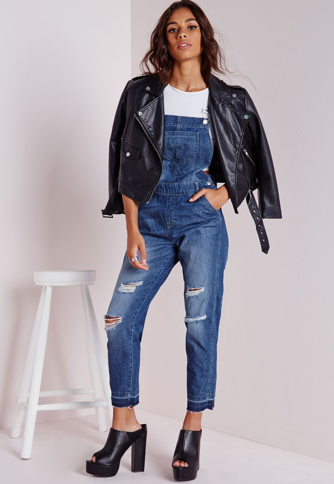 b627d6310ef We have fallen head over heels for these denim overalls which falls  perfectly on to our lust list. These super fierce overalls feature ripped  detial down ...