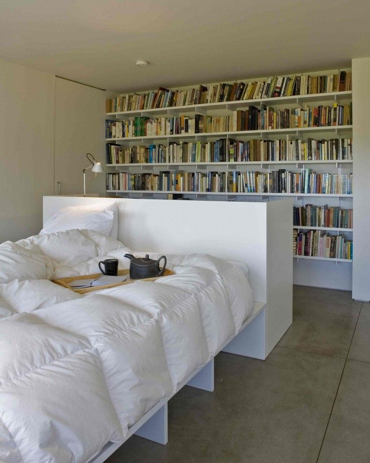 Bedroom in a contemporary Maine house built on a budget, designed by architect Bruce Norelius | Remodelista