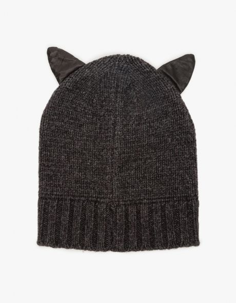 Wool blend knit beanie with small faux leather kitty ears. Features ribbed knit and simple styling.  •	Textured knit hat •	Cat ear accents •	80% Wool, 20% Nylon