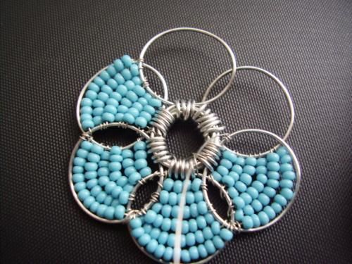 Wire/Bead Flower. Site is not in English, but the pictures are easy enough to follow.