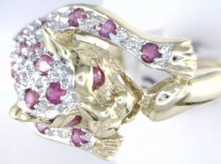 14KT YELLOW GOLD RUBY AND DIAMOND CAT RING.