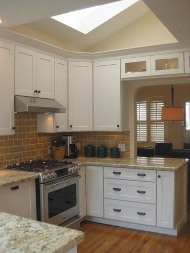 Love this kitchen with the pale gold tiled walls and large window