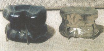 """In Roman culture, tali were made from multiple different materials. The tali on the left is made from onyx and the one on the right was made from the rock crystal.""""Roman Board Games --"""