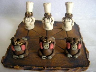 Tres en raya: cocinero-cerdos. ¡Pesadilla en la cocina!