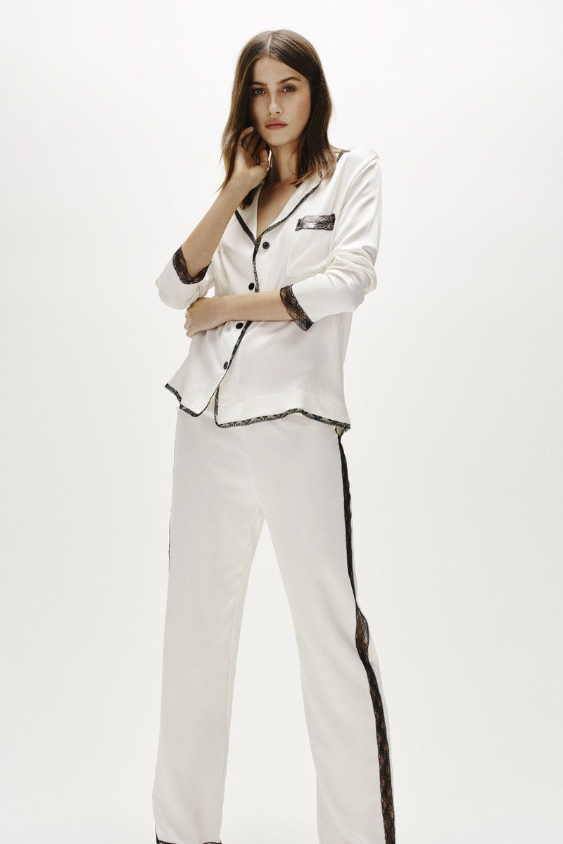 Look amazing in our luxury white silk pyjama set with a cool masculine  undertone. Dress it up for a chic evening look or enjoy it at home. 7acd8e4e4
