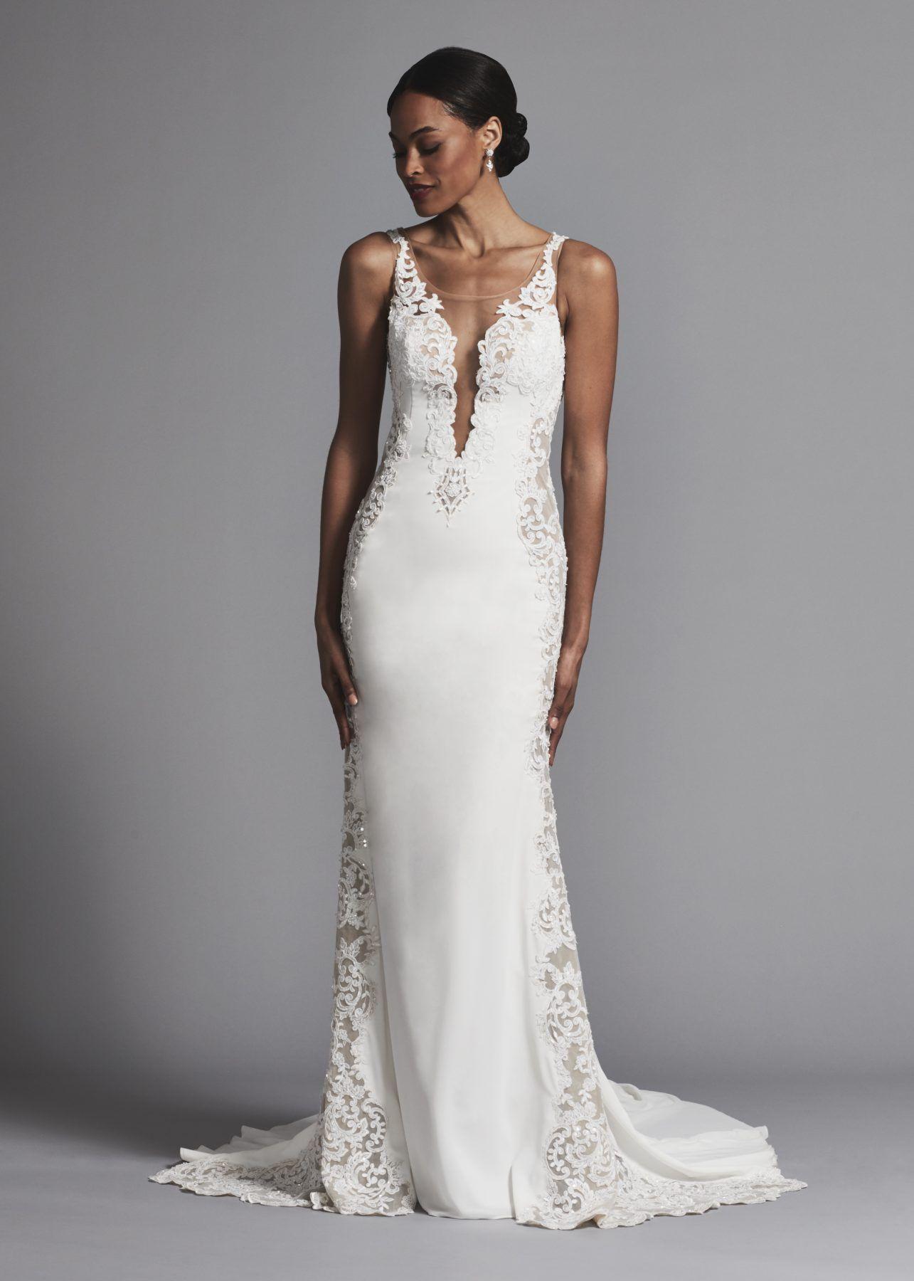 Sheath illusion wedding dress with lace cutouts and deep vneckline
