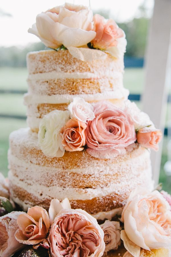 Naked strawberry cake w/ soft ranunculus and peonies <3