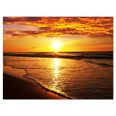East Urban Home This 'Bright Yellow Sunset over Waves' Graphic Art is printed using the highest quality fade resistant ink. Format: Wrapped Canvas, Size: 12