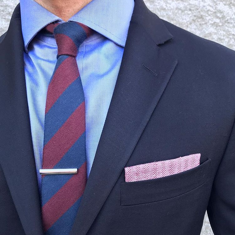a42da58156f5 Even if your feet are feeling the winter chill don't let your outfit cool  off too! Add some warmth with our Striped Wool Skinny Tie in Navy and  Burgundy.