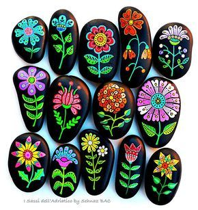 Beach stones with hand-painted designs in acrylics © Sehnaz Bac 2017 I paint and draw all of my original designs by