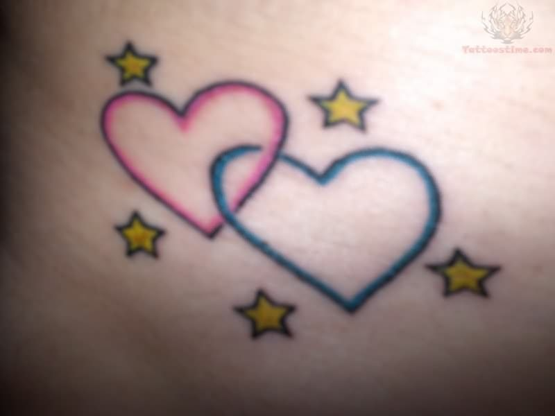 hearts, moon and stars wrist tattoo - Maybe do five hearts interlocking and in everyone's birth stone colors.