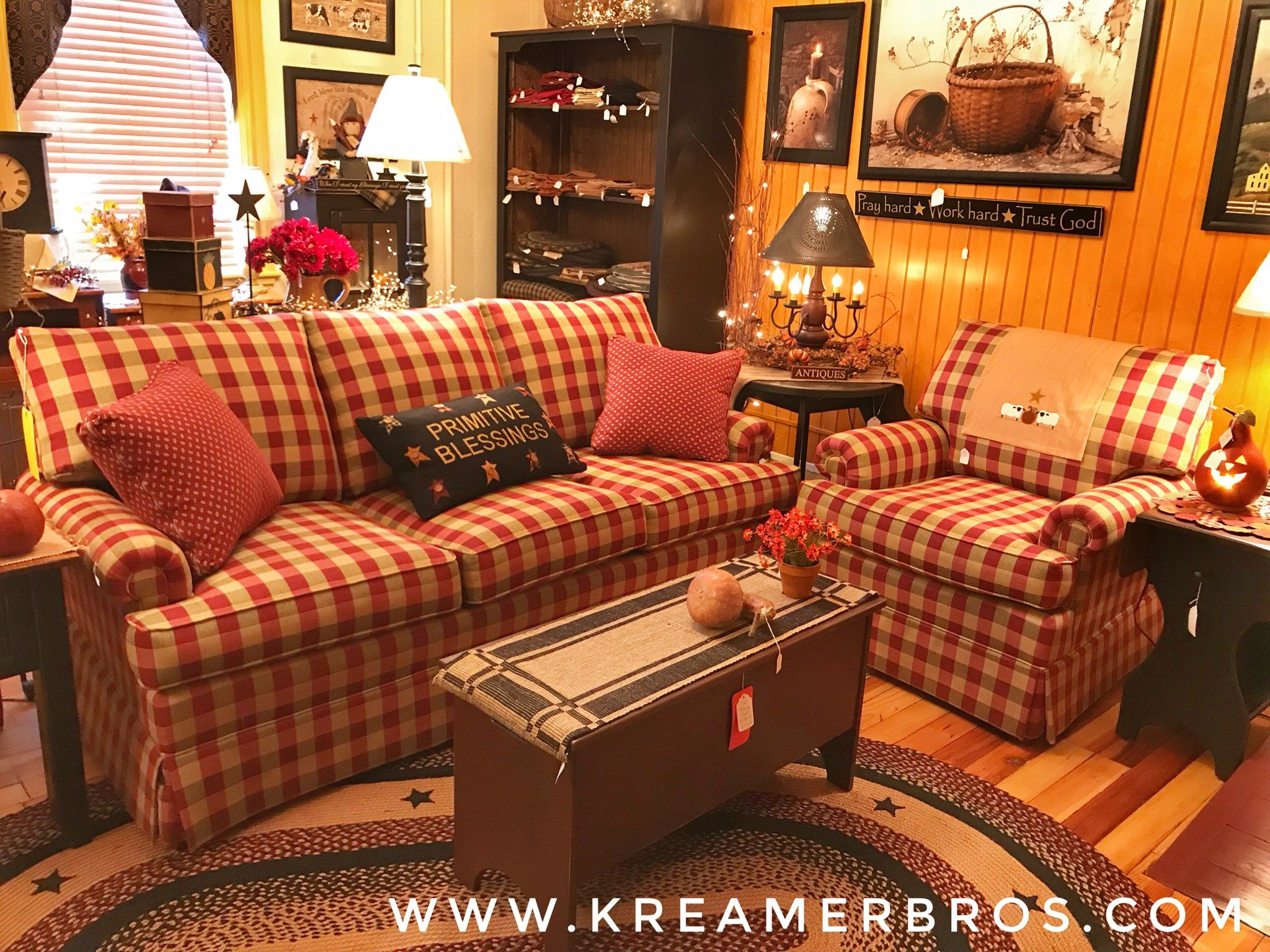 Red check country style sofa with soft, plush cushions