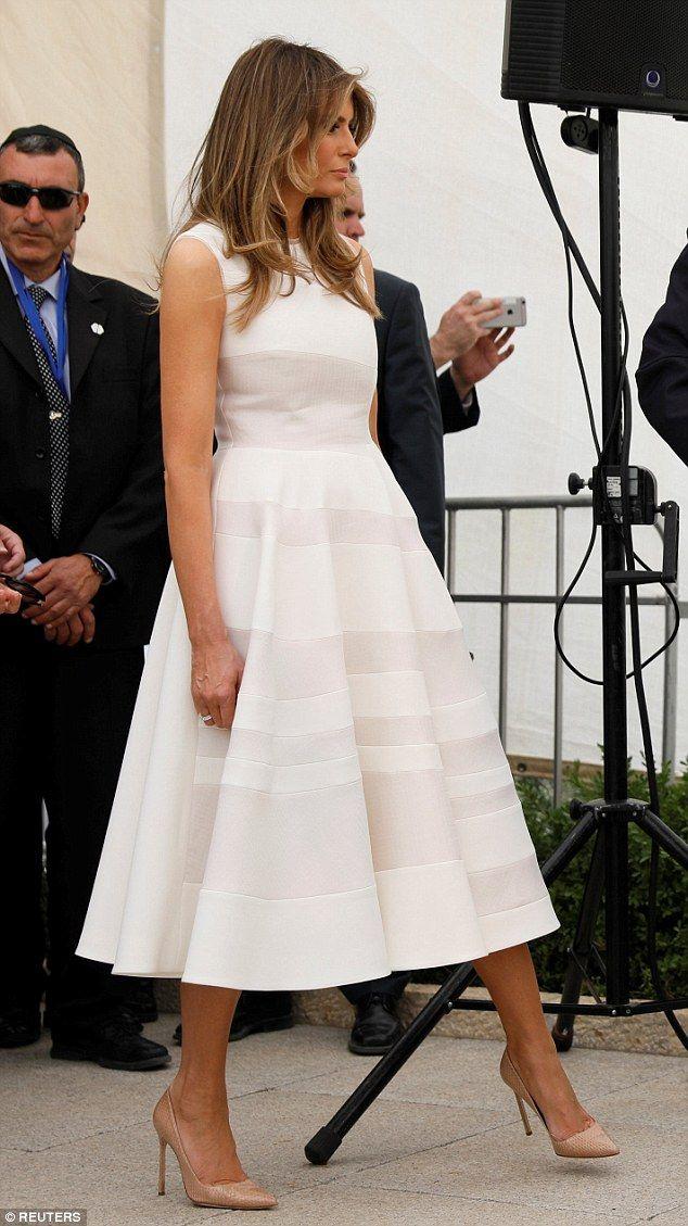 Look demure in a Roksanda midi dress like Melania. Click 'Visit' to buy now. #DailyMail