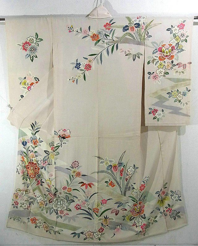 This is a hitoe(not lined) kimono from Showa period (1926- 1989).  It has a design of flower such as 'botan'(peony), 'ume'(Japanese plum) and iris on bridge, which is dyed colorfully.