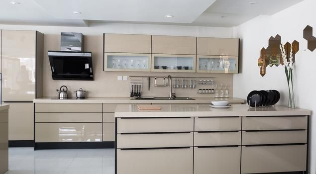 Polished Tan Modern Kitchen With Glass Front Cabinets And White Finish Counter Tops