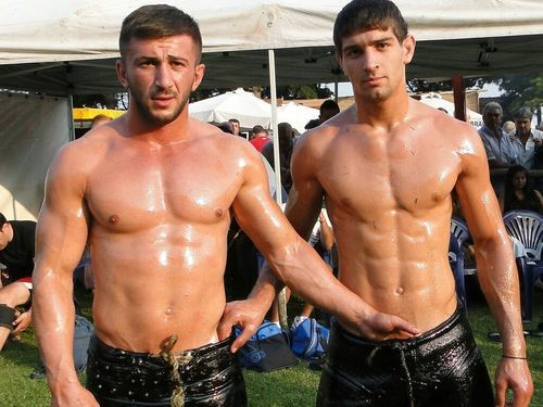 two beefcake guys have oiled massage