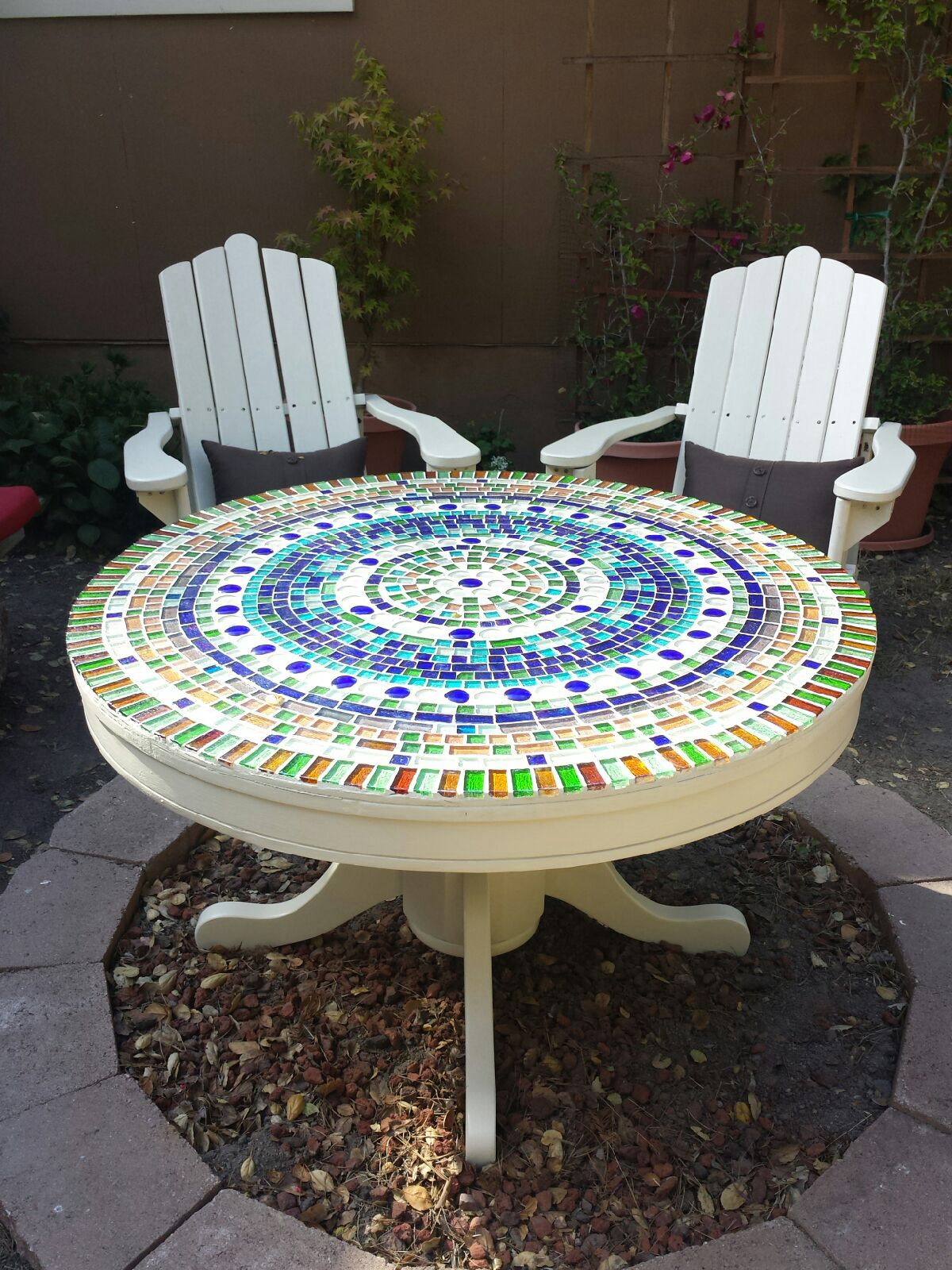 Here's my first mosaic table....modified oak kitchen table ...