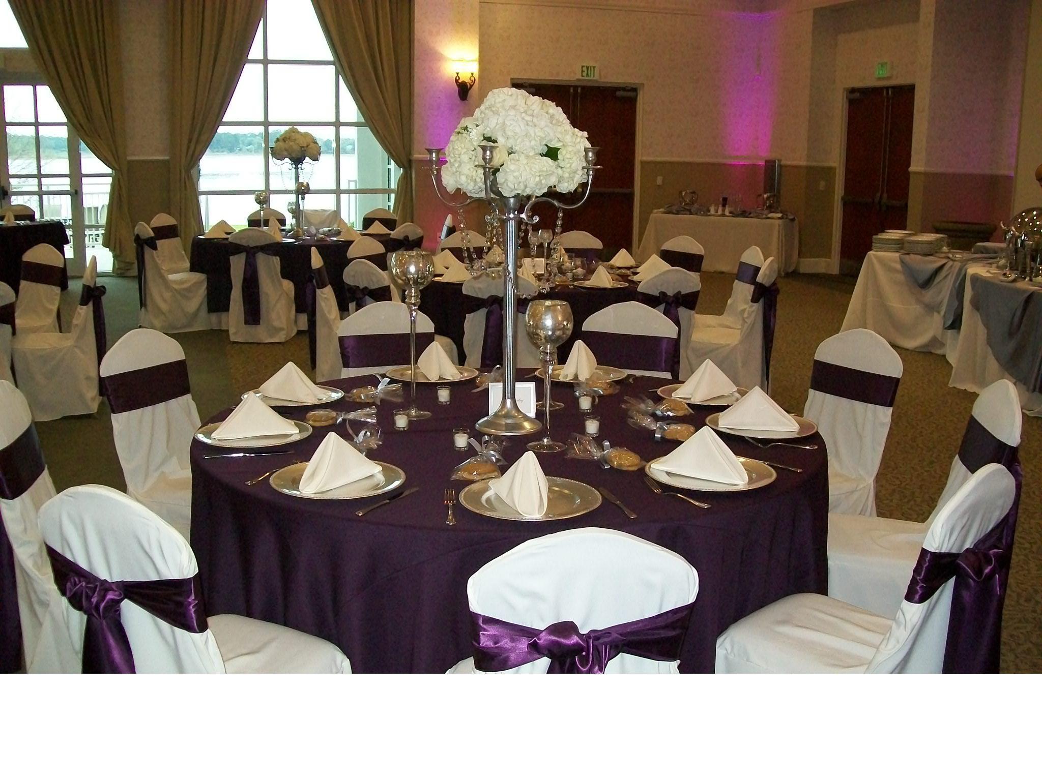 White Base Linen With A Full Eggplant Poly Overlay, White Poly Napkins,  White Ballroom Chair Covers With Eggplant (Plum) Satin Sash.