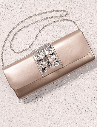 Make any occasion a little more special with our patent clutch bag shimmering with faux jewels. Keep your night-out essentials close at hand or wear over the shoulder with the attached chain strap. Lined interior includes one technology pocket. Snap closure. lanebryant.com