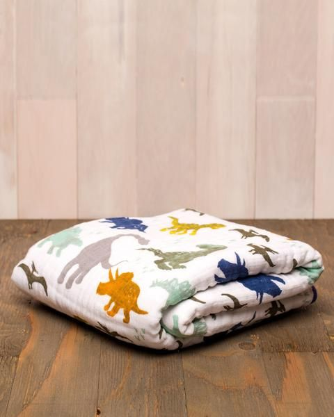 """https://Poshinate.com -      47"""" x 47"""" cotton muslin quilt     4-layer 100% cotton muslin     breathable     softer with each wash     machine washable     original prints to fit your unique style"""