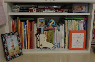 Book shelf with stories and craft books and trinkets