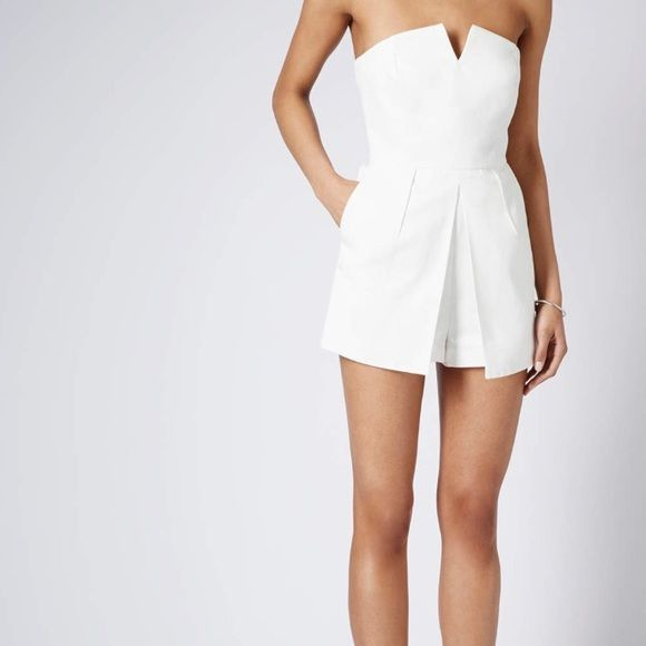 Topshop White Bandeau Skort Playsuit Cute and sassy Skort dress. Never worn. Size 4, but fits like a size 2. Check out: http://www.lyst.com/clothing/topshop-bandeau-skort-playsuit-ivory/ Topshop Dresses Strapless