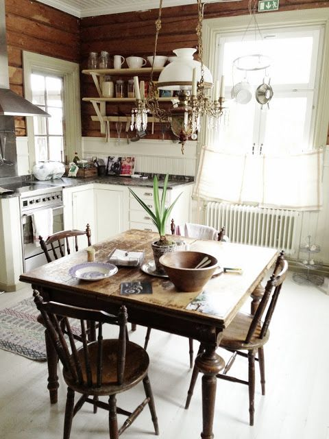 Cosy kitchen-note oil lamp over table