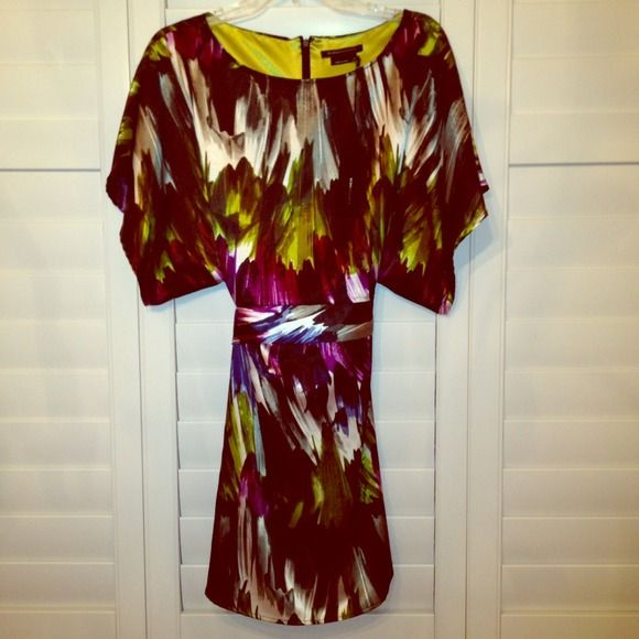BCBG Kimono Sleeve Tunic Super chic jewel tone print tunic top. Satin polyester material, it feels smooth like silk. It has kimono sleeves and ties in the back to show off the waistline . NWT. Never worn, BCBGMaxAzria Tops Tunics