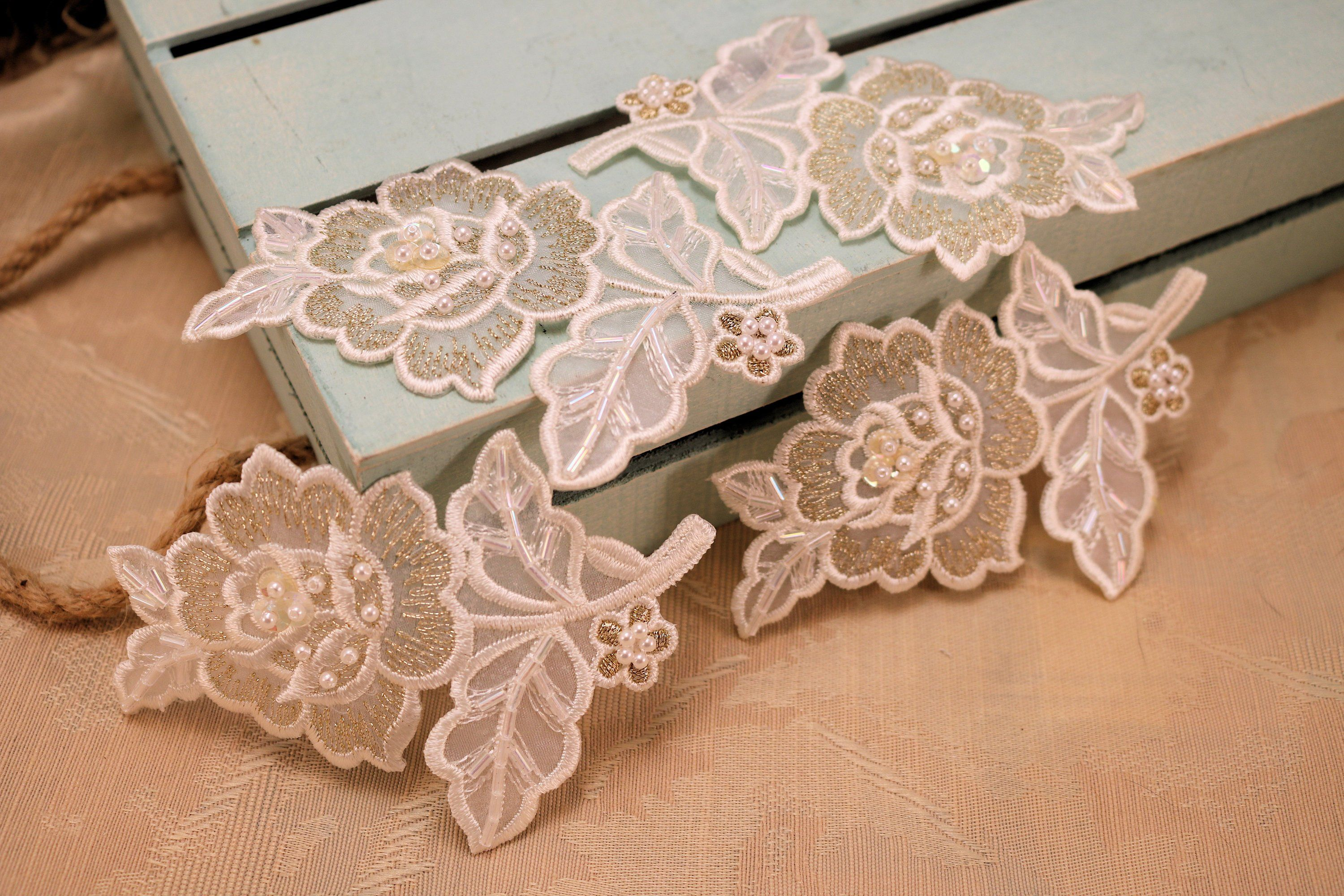 By white fabric with variegated embroidery applique