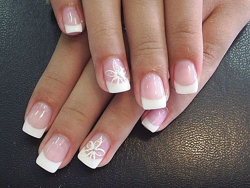 One can choose to create fabulous flowers on a French style manicure ...