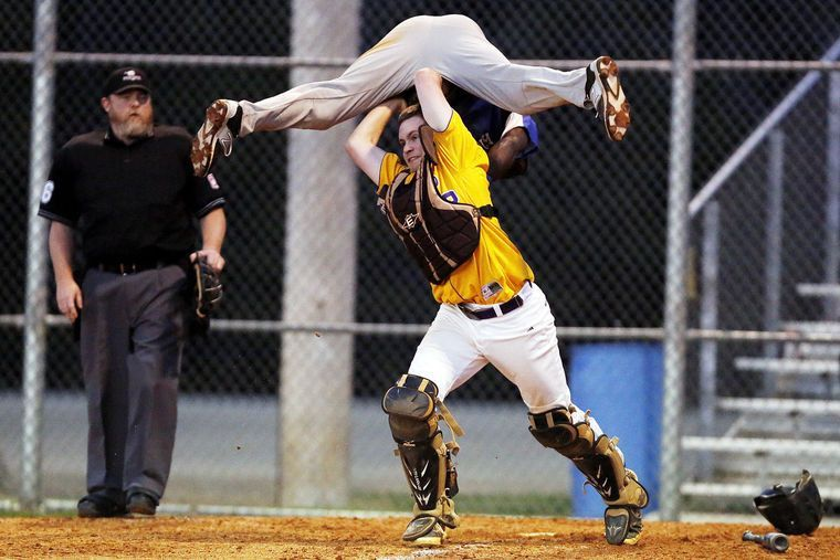 Crazy Picture Of A High School Baseball Catcher Tagging Out A Runner Who Tried To Jump Over Him Softball Catcher Fastpitch Softball Fastpitch