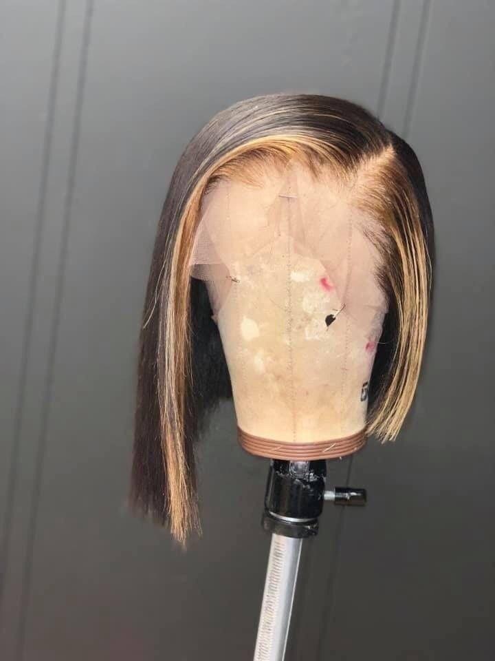 Human hair asymmetrical bob cut with blonde highli