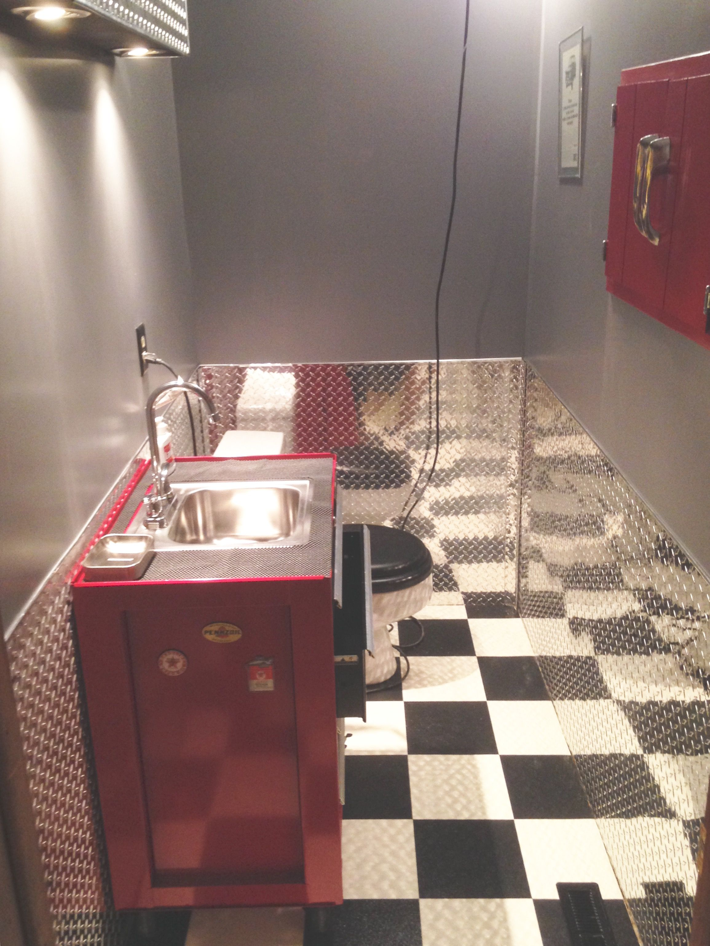 Now this is a bathroom! Diamond Plate Wainscot and a converted ...