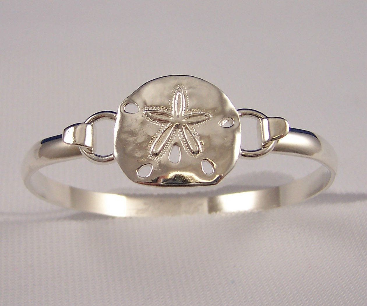 Cape Cod Convertible Sterling Silver Sand Dollar Bracelet. $99.95, Via Etsy.