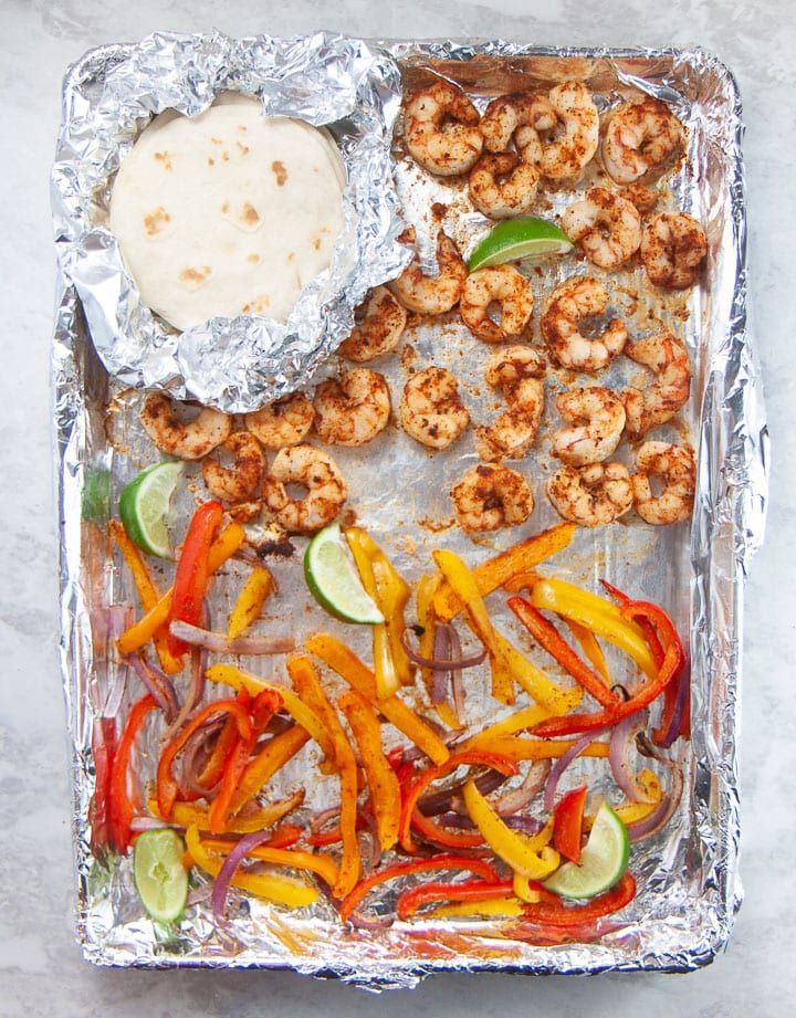 These Family-Favorite Sheet Pan Shrimp Tacos are a fast 15-minute family meal that everyone will love - from baby to adults! This meal is so versatile that you can make them gluten-free, dairy-free, low-carb and even vegetarian! #familymeal #favorite #family #baby #toddler #dinner