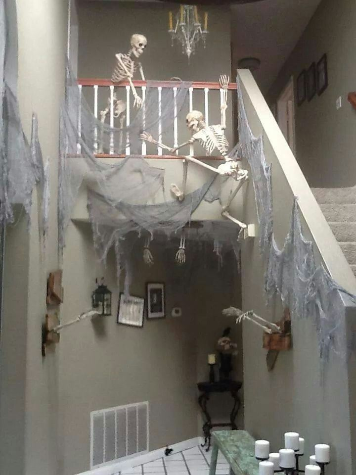 Halloween decorations - skeletons climbing staircase with cobwebs - halloween decorations skeletons