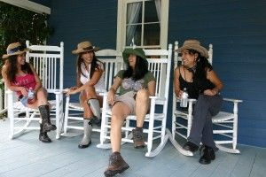Cowgirls taking a break on the porch during their getaway to the BlissWood Bed and Breakfast located in Cat Spring, TX. #bedandbreakfast #travel #girlfriendsgetaway