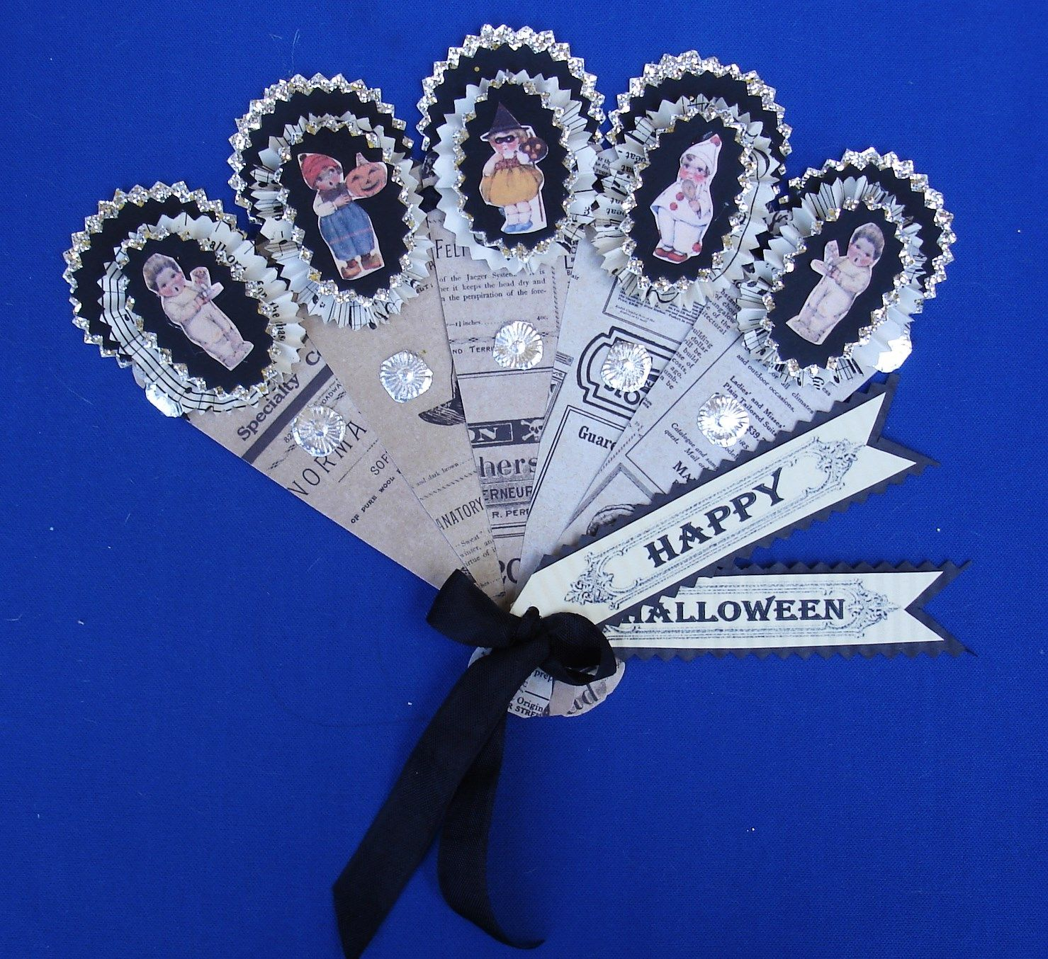 Vintage inspired hand made by Susan Arnot. Halloween paper fans. Comes in vintage ad paper, black and orange. Available in my etsy shop $10.00 each.