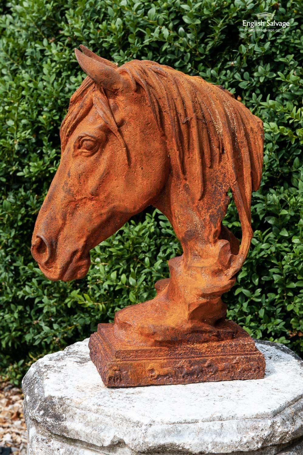 Pair of large horse head cast iron statues Available now