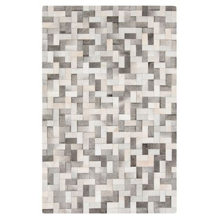 Anchor your living room seating group or define room in the den with this hand-woven cowhide and leather rug, showcasing a geometric motif for eye-catching a...